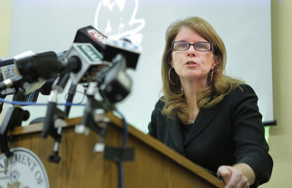 Mary Mayhew, commissioner of the Department of Health and Human Services, discusses findings of a report done by the Alexander Group about the cost of expanding MaineCare while talking to reporters at the Department of Health and Human Services in Augusta on Friday, January 10, 2014.