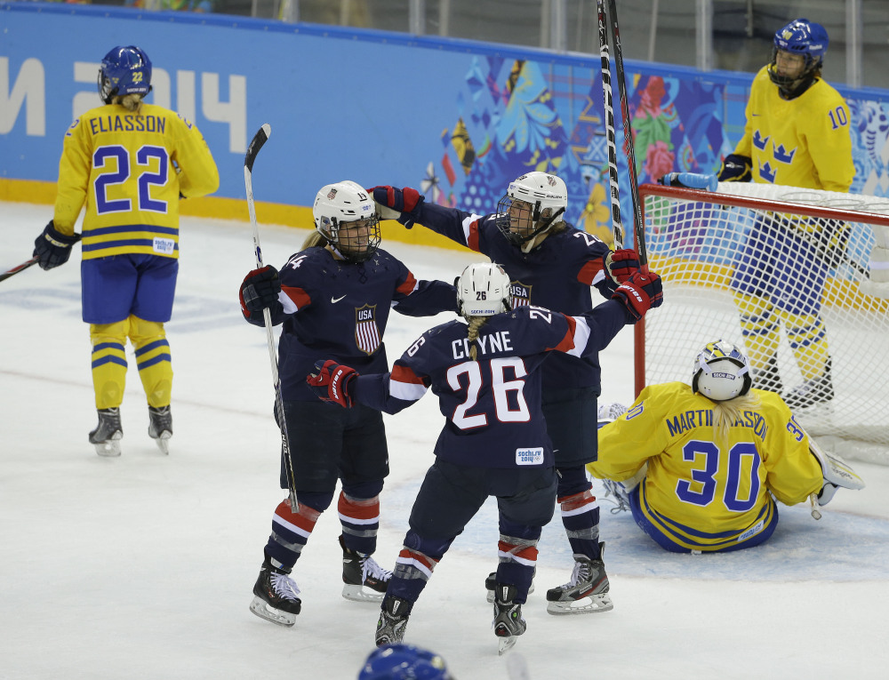 Brianna Decker of the United States (14), Kendall Coyne (26) and Amanda Kessel celebrate a goal by Decker against Sweden during the third period of the 2014 Winter Olympics women's semifinal ice hockey game at Shayba Arena on Monday in Sochi, Russia.