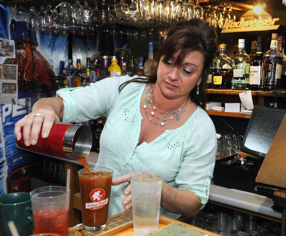 GOOD BUSINESS: Bartender Kerrie Guite pours a Bloody Mary on Friday at Lisa's Restaurant and Catering on Bangor Street in Augusta.