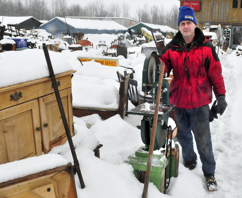 TRASH OR TREASURE?: Robert Dale, owner of 201 Antiques, stands in the middle of a sprawling collection of household items, farm equipment, glass and metal items outside in Fairfield on Thursday. The town has ordered Dale to clean up the site and pay more than $9,000 in legal fees.