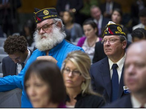 "Members of the American Legion listen as Veterans Affairs Secretary Eric Shinseki testifies at a Senate committee hearing on the state of health care for veterans. Shinseki said he was ""mad as hell"" about allegations that some VA hospitals falsified reports so it looked like their wait lists were shorter."