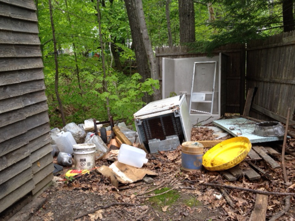 PIles of rubbish: Neighbors have had enough of growing mounds of trash outside buildings taken by the city for non-payment of taxes.