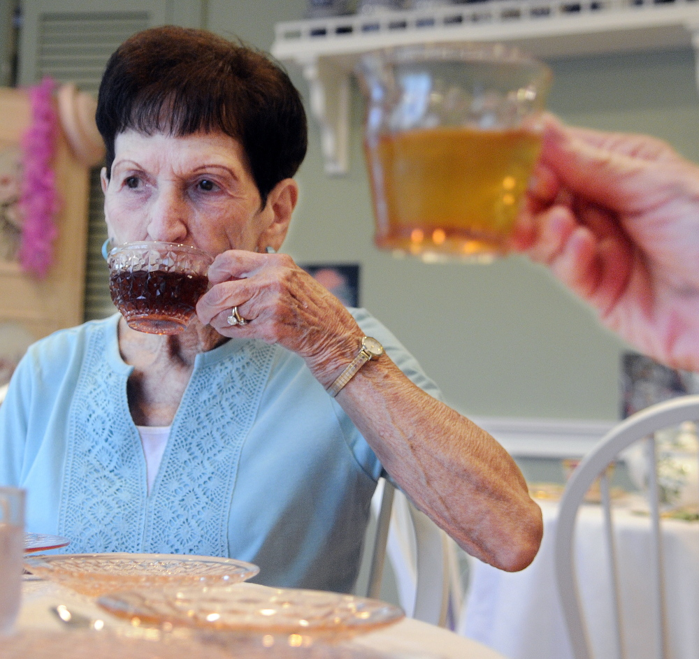 Phyllis Lynch, left, and Diane Jerome have tea Monday at the Blue Willow Tea Room in Randolph.