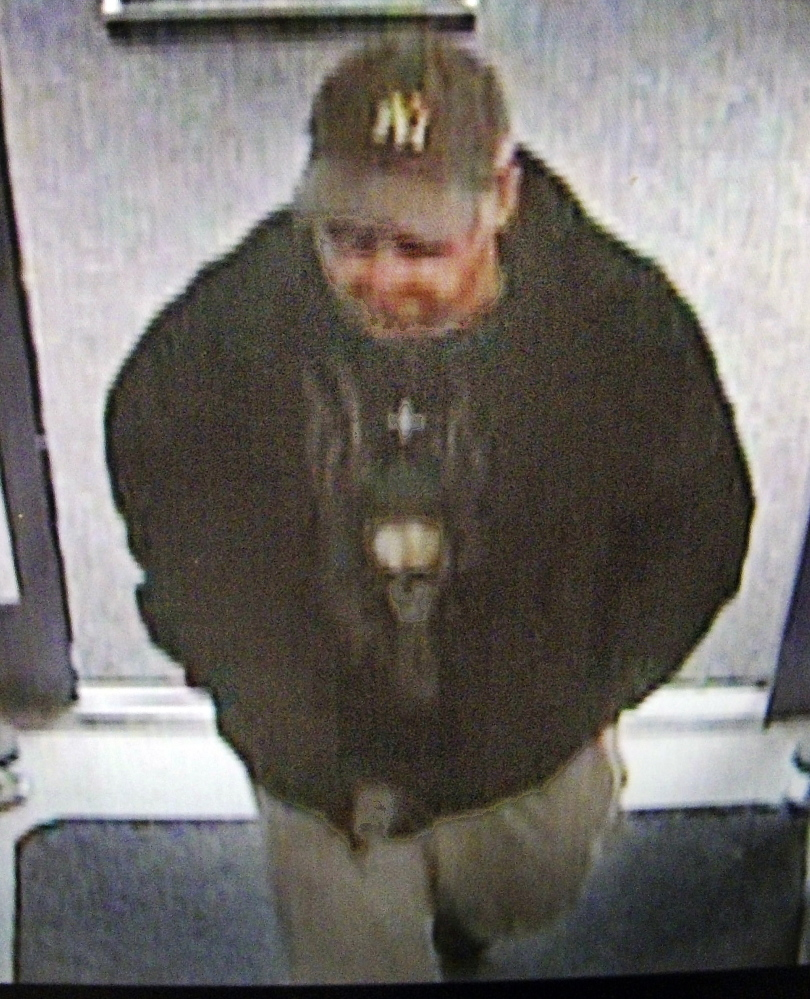 A surveillance photo shows a suspect who allegedly robbed the Rite Aid pharmacy in Manchester on Sunday.