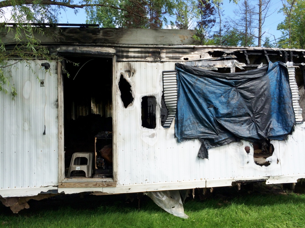 A Farmington mobile home damaged by a March fire must be torn down by mid-October.