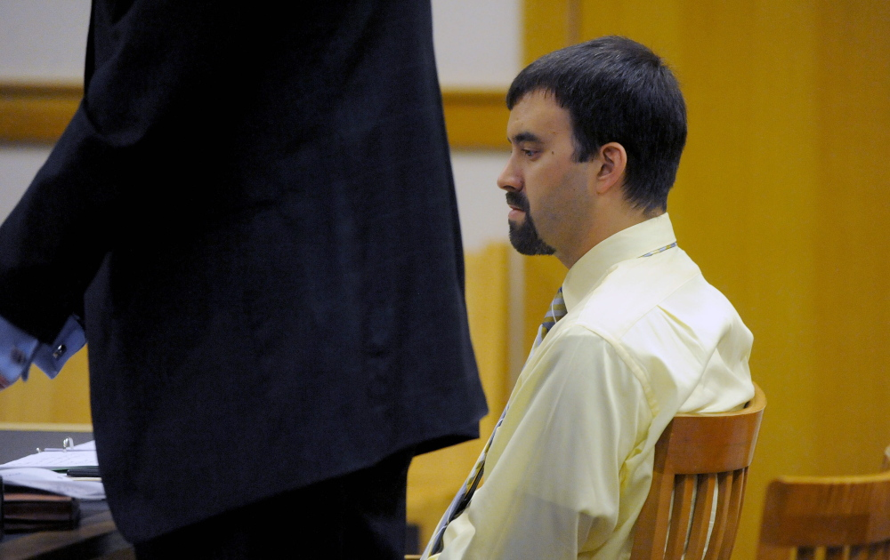 Andrew Maderios makes his initial appearance in Somerset County Superior Court in Skowhegan on Wednesday. Maderios' attorney, Leonard Sharon, stands by his side.