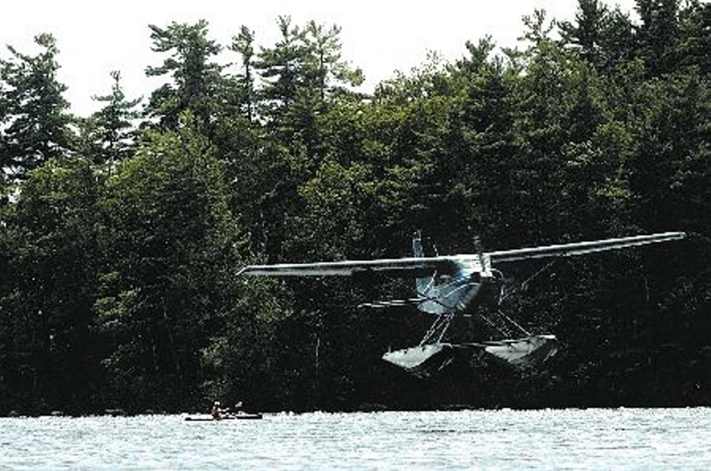 Staff file photo by Jeff Pouland A float plane piloted by Bill McKay of Oakland approaches the water while making a landing on Messalonskee Lake in Oakland in August, 2006. A float plane piloted by McKay crashed in Quebec Tuesday. McKay died in the crash while an adult son and daughter survived.