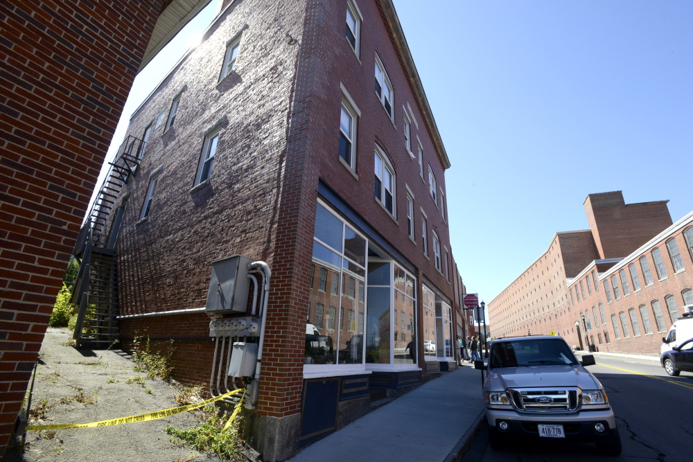 Crime scene tape blocks an alley Friday at 35 Main St. in Biddeford after an arsonist set fire to the complex Thursday.