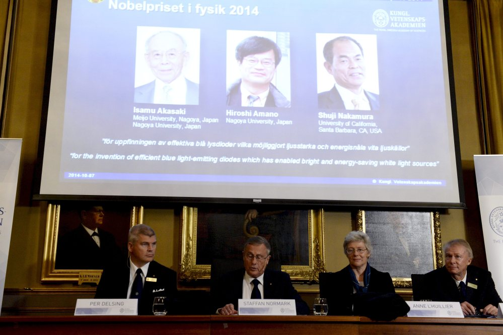 Per Delsing, left, Staffan Nordmark, centre left,  Anne L´Huillier, and  Olle Inganas announce the Nobel prize  laureates in physics at the Royal Swedish Academy of Science in Stockholm, Tuesday.