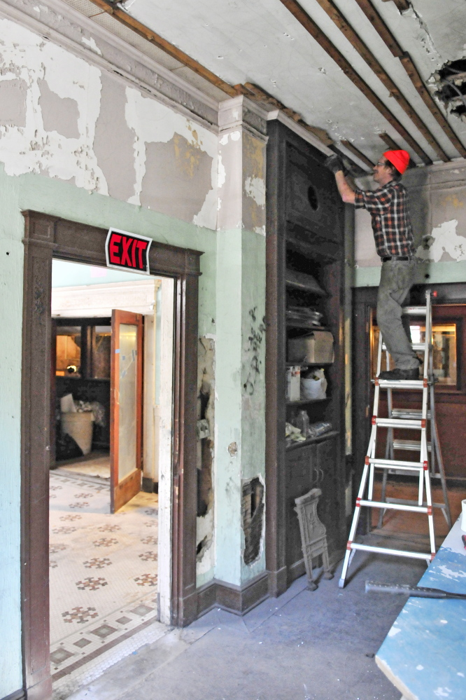 Chris Selwood works in the office of the old Colonial Theater on Oct. 8 in Augusta. He's a volunteer with a group that is trying to renovate the theater, which opened in 1913 at 137 Water St. The theater is open 10 a.m. to 2 p.m. Saturday for an open house and tours for the last time this year.