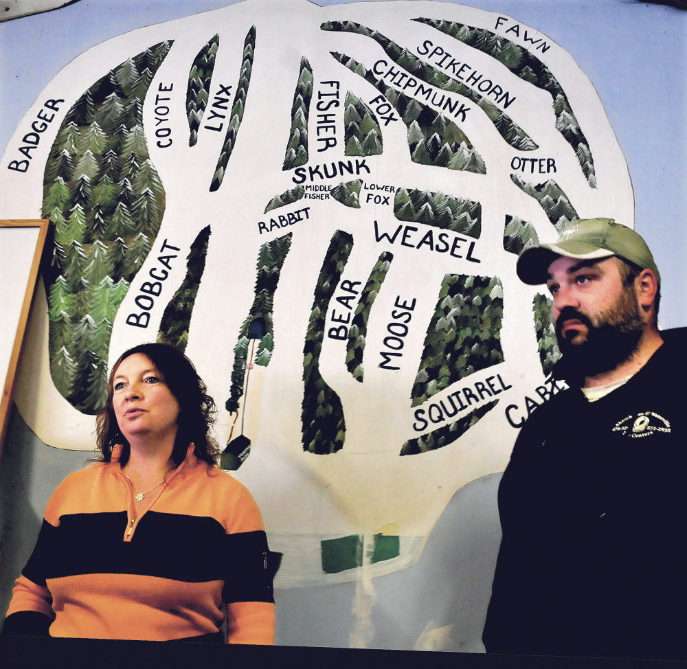 Julie Keaten, manager at Eaton Mountain Ski Area, and employee Jason Dumais were readying the resort on Sunday so that downhill skiing will be available this season on some of the trails designated in the map behind them for the first time since owner Dave Beers bought the business in 2008.