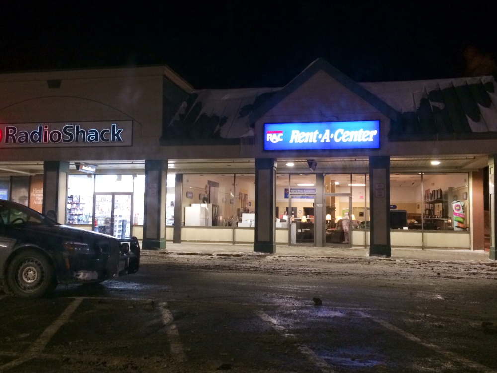 A masked gunman robbed the Rent-A-Center store in the Elm Plaza shopping area off  upper Main Street in Waterville at about 7:30 p.m. Police say the man showed a Glock handgun and took off with a bank deposit bag.