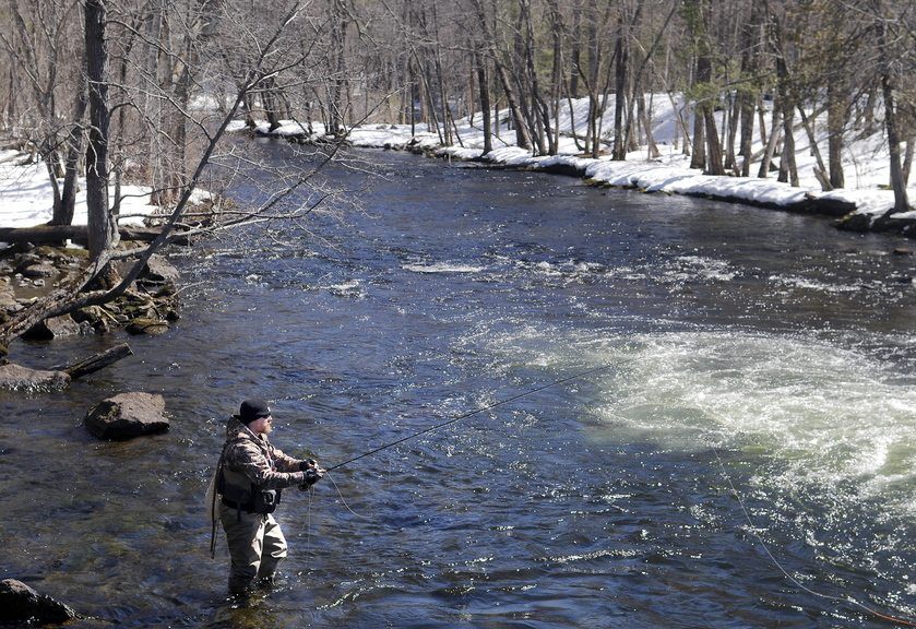 Travis Parlin, of Fairfield, casts a set of nymphs into Cobbosseecontee Stream on Tuesday in Manchester beneath a clear sky. Anglers planning to toss a line into other bodies of water across the state that open Wednesday with the commencement of fishing season will encounter similar conditions, according to the National Weather Service, with plenty of sun and temperatures in the upper 30s.  Parlin said he's been addicted to connecting flies and fish since he was a freshman in high school.