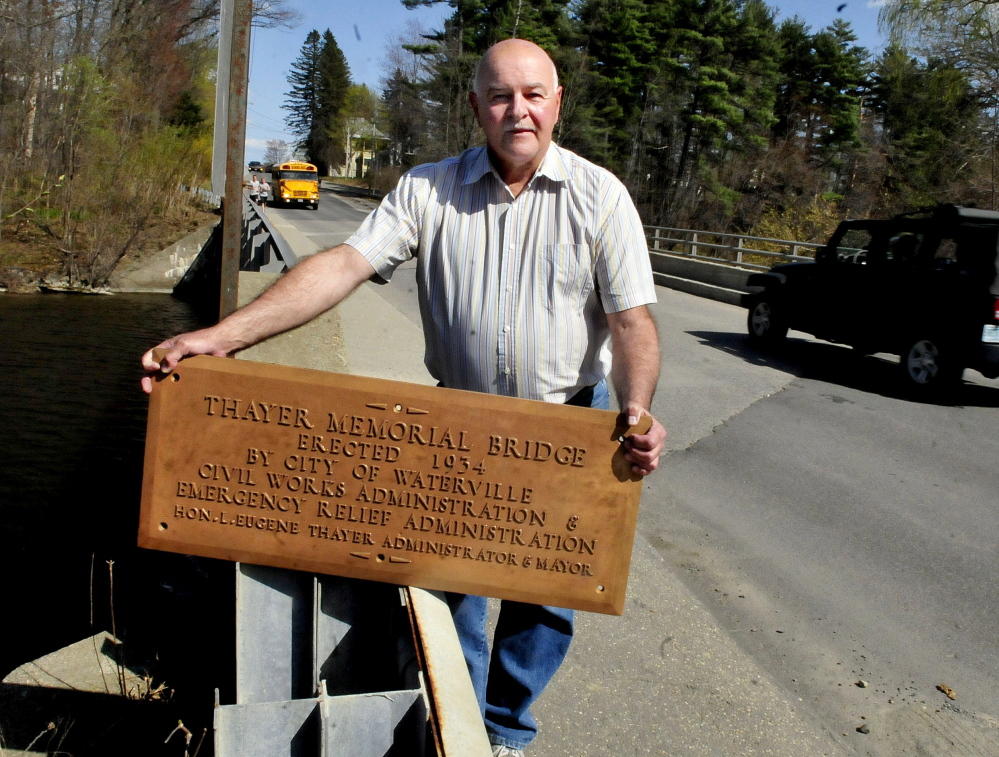 Waterville Public Works Director Mark Turner holds a bronze plaque Wednesday that was recently found in a home that was being demolished and turned over to the department. The plaque was erected in 1935 on the Gilman Street Bridge in Waterville in honor of former Mayor L. Eugene Thayer. It disappeared many years ago.
