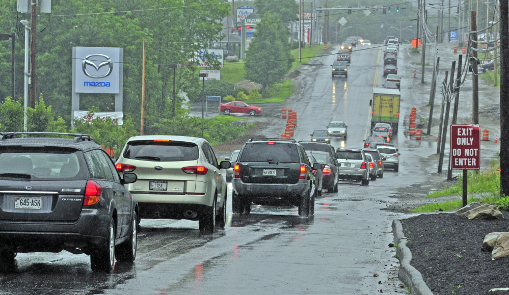 This file photo taken July 16, 2014, shows eastbound Western Avenue traffic near the intersection of Woodside Road in Augusta, where a woman hit a pothole while riding her motorcycle and died nine days later.