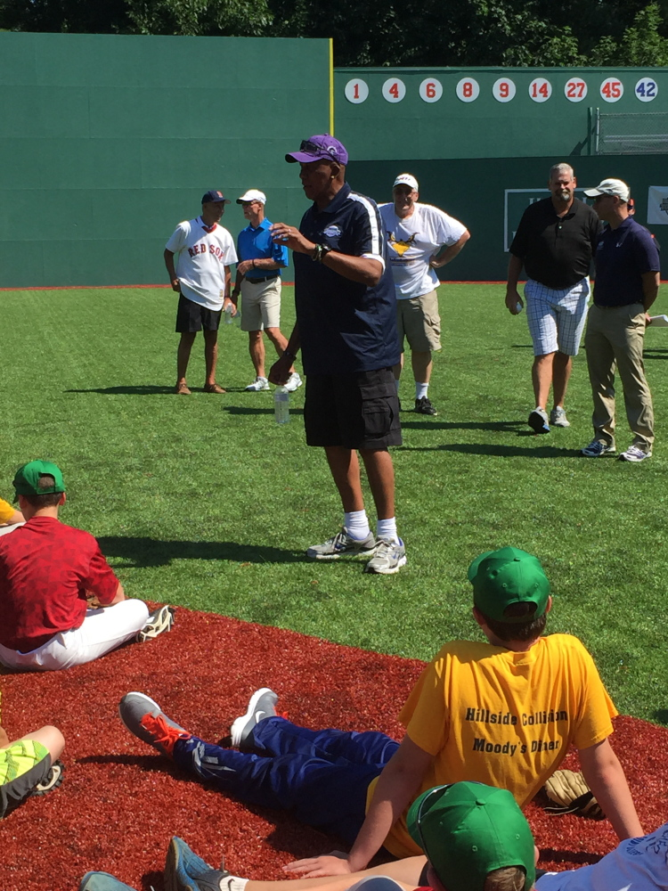 Major League Baseball Hall of Famer Ferguson Jenkins talks to players in August 2015 at Harold Alfond Fenway Park at Camp Tracy.