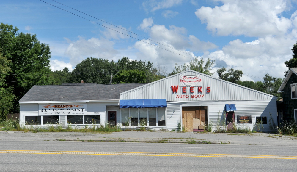 The former Weeks Auto Body building on Kennedy Memorial Drive in Waterville, seen Saturday, stands on the site where Jerald Hurdle wants to build a 24-hour automated car wash.