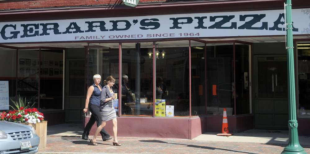 Gerard's Pizza reopened Monday at the restaurant's Water Street location in Gardiner after closing because of a fire in neighboring buildings on July 16.