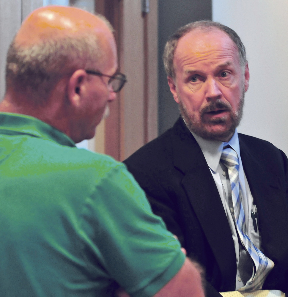 Attorney Bill Lee, right, speaks with Fairfield Fire Chief Duane Bickford following a brief hearing with Robert Dale in Skowhegan District Court on Monday.
