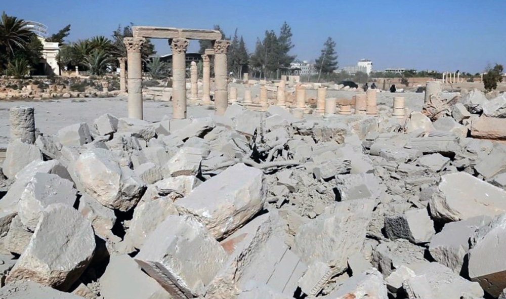 This undated photo released Tuesday, Aug. 25, 2015 on a social media site used by Islamic State militants, which has been verified and is consistent with other AP reporting, shows the demolished 2,000-year-old temple of Baalshamin in Syria's ancient caravan city of Palmyra.