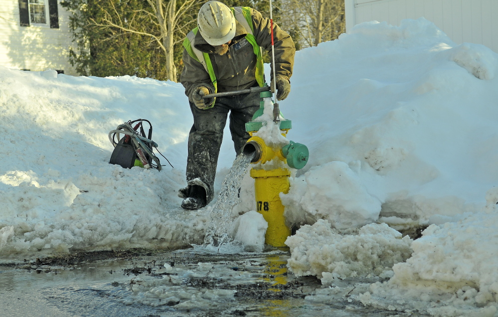 Darrell Field, of the Kennebec Water District, works on a water line in February in Waterville. Employees of the district will benefit from a $1.4 million refund from the Maine Public Employees Retirement System, which the district is putting back into retirement payments.