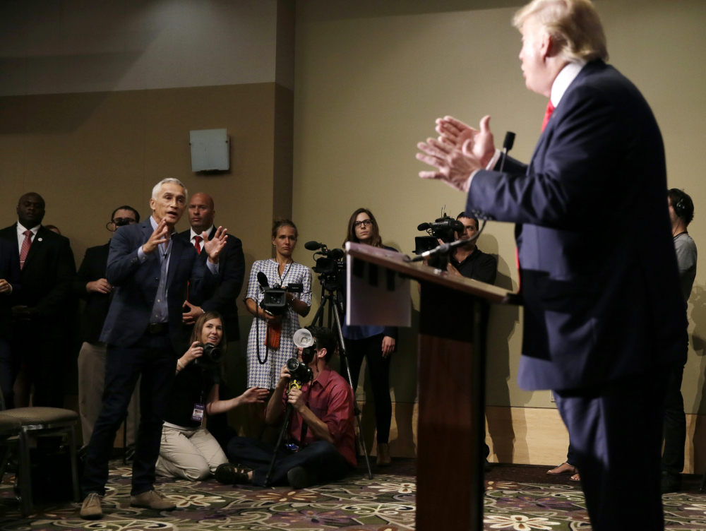 Miami-based Univision anchor Jorge Ramos, left, asks Republican presidential candidate Donald Trump a question about his immigration proposal during a news conference, Tuesday, in Dubuque, Iowa.