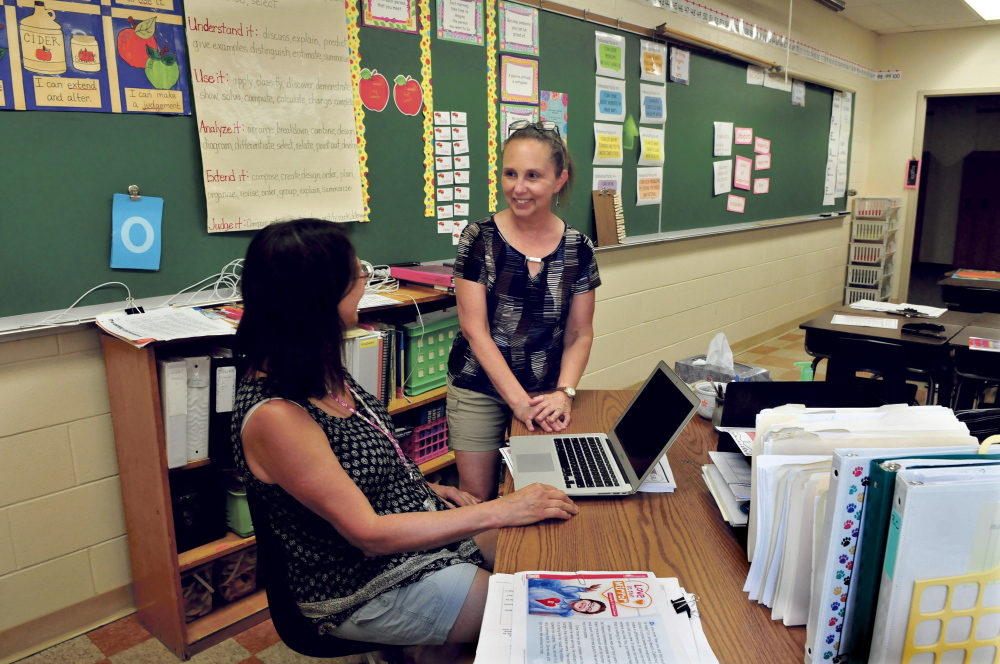Academy Hill School teacher Brenda LaVerdiere, right, speaks with teacher Leslie Kaiser at the Wilton school on Wednesday. LaVerdiere is one of three finalists state Teacher of the Year.