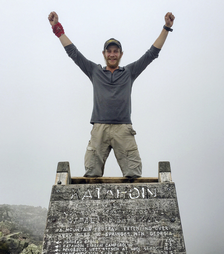 In this Aug. 5 photo provided by Jackson Spencer, Spencer poses atop Mount Katahdin along the Appalachian Trail near Millinocket. Spencer, who finished the entire trail in just 99 days, said he was looking forward to enjoying the wilderness and getting away from it all. Instead he often found the trail filled with trash, graffiti and people who seemed more interested in partying all night.