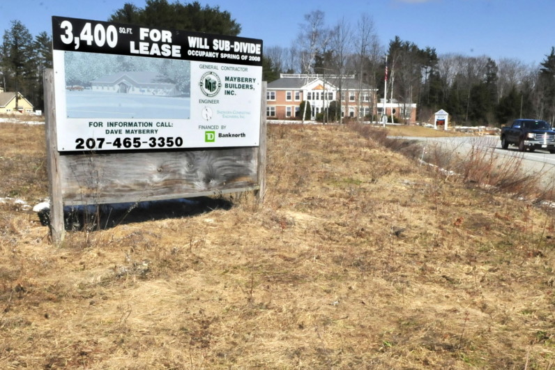 A sign advertising retail space at FirstPark in Oakland last year in a field beside current tenants Kennebec Veterinary Services, left, and PFBF company. The town of Rome is asking the Kennebec Regional Development Authority and First Park to specify long-term costs and benefits of the arrangement they have with the park and outline ways towns and cities can leave the authority.
