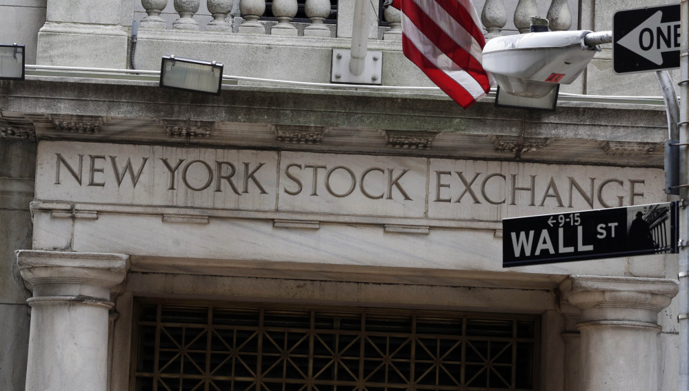 This Oct. 2, 2014, file photo, shows the Wall Street entrance of the New York Stock Exchange.