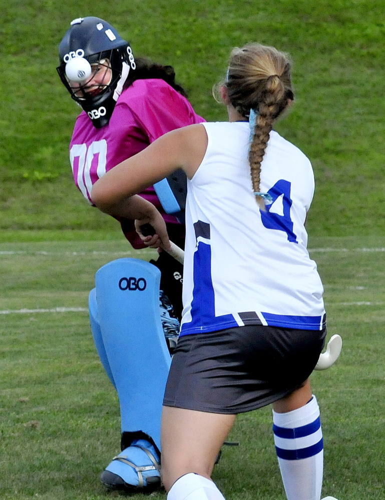 Staff photo by David Leaming   Nokomis goalie Chelsey Crockett keeps her eye on the ball as Lawrence's McKenna Rogers applies pressure during a Kennebec Valley Athletic Conference Class B game Thursday. Lawrence prevailed 4-1.