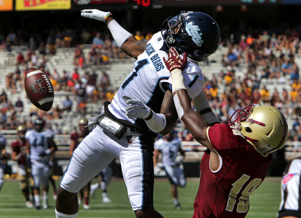 Barry Chin/The Boston Globe via AP Maine defensive back Najee Goode (1) breaks up a pass intended for Boston College wide receiver Thadd Smith (18) in the first quarter Saturday in Chestnut Hill, Mass.