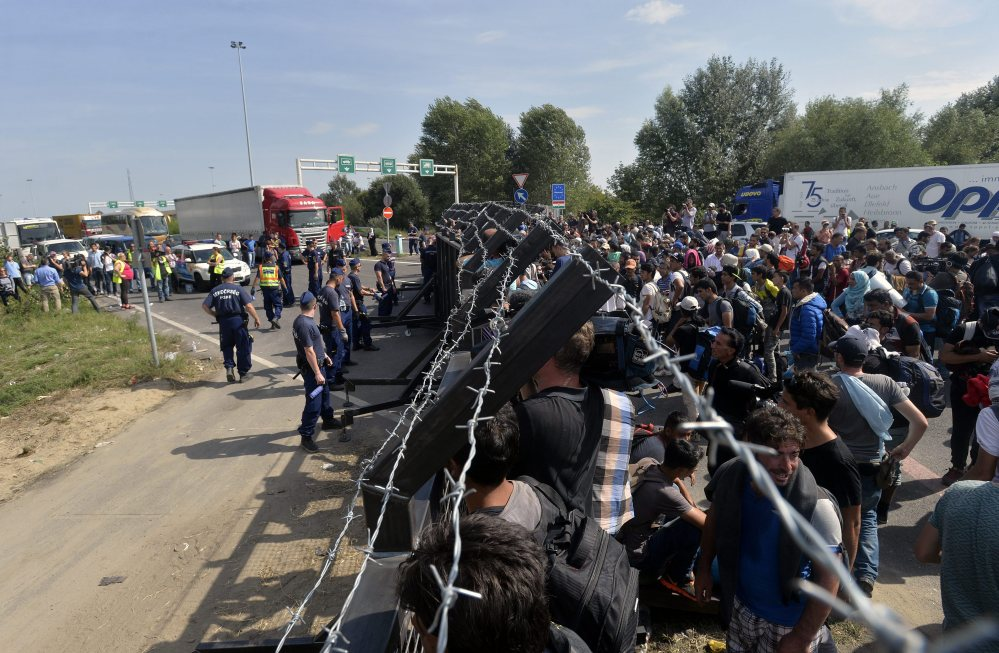 Refugees wait at the closed border station between Serbia and Hungary in Horgos, Serbia, Tuesday.