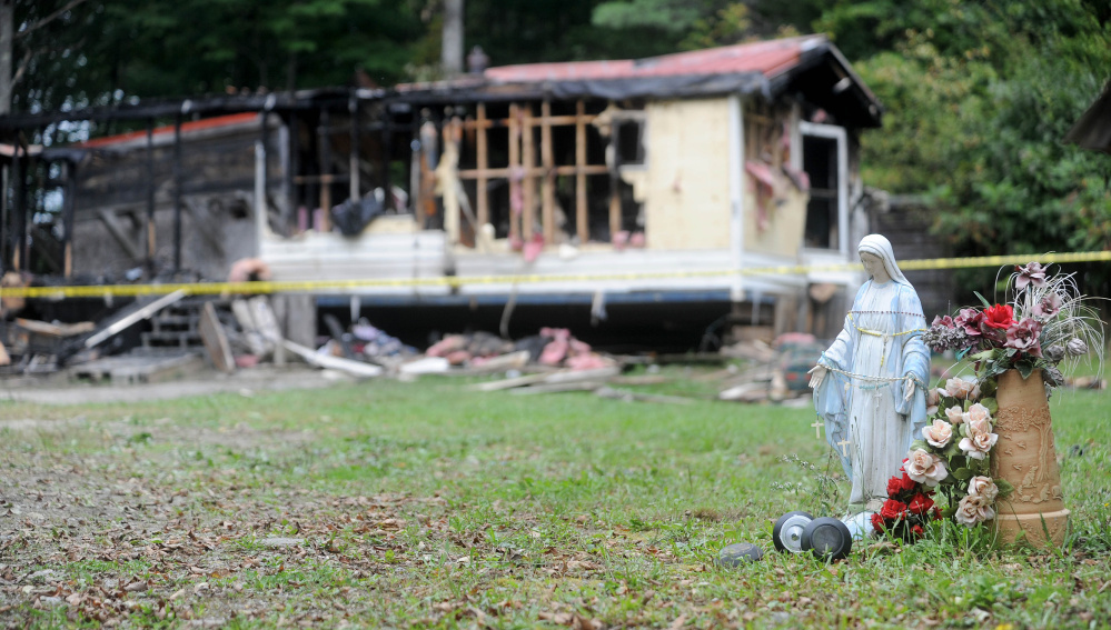 A mobile home at 289 Brown's Corner Roadd in Canaan was destroyed in fire on Monday. This photo shows the charred remains on Tuesday, Sept. 22, 2015. It is the third fire in that town in three weeks.