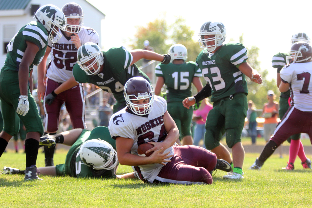 Photo by Jeff Pouland   Maine Central Institute's Curtis McLeod hauls in a two-point conversion during the third quarter of last Saturday's game against Mount View High School in Thorndike. McLeod plays offensive and defensive tackle for the Huskies.
