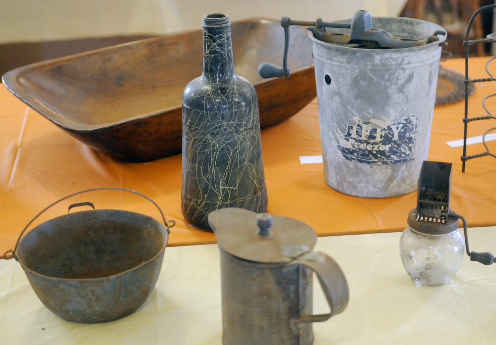 Items on display at the Manchester Grange on Thursday in preparation for an exhibit by the Manchester Historical Society on Sunday.