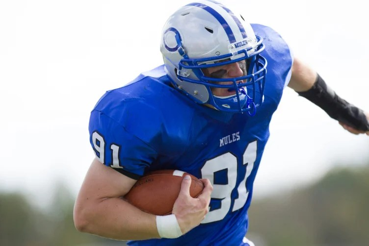 Contributed photo/Colby College   Stephen O'Grady returns an interception during a 2013 game. O'Grady returns as one of the leaders on the Mules.