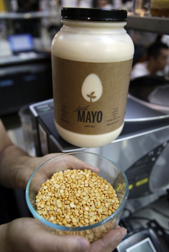 Hampton Creek's CEO Josh Tetrick holds a bowl of yellow peas used to make Just Mayo, the startup's eggless, plant-based mayonnaise.
