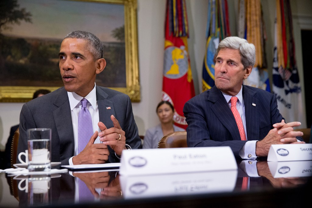 President Barack Obama, accompanied by Secretary of State John Kerry, meets with veterans and Gold Star Mothers to discuss the Iran nuclear deal at the White House on Thursday, when it survived a Republican effort to block it.