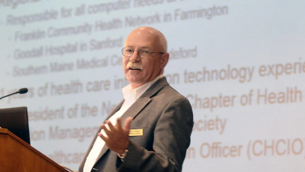 Ralph Johnson, a member of the ConnectME Authority, speaks Sunday at the University of Maine at Augusta, stating that broadband connections can enable people to manage chronic disease from home.