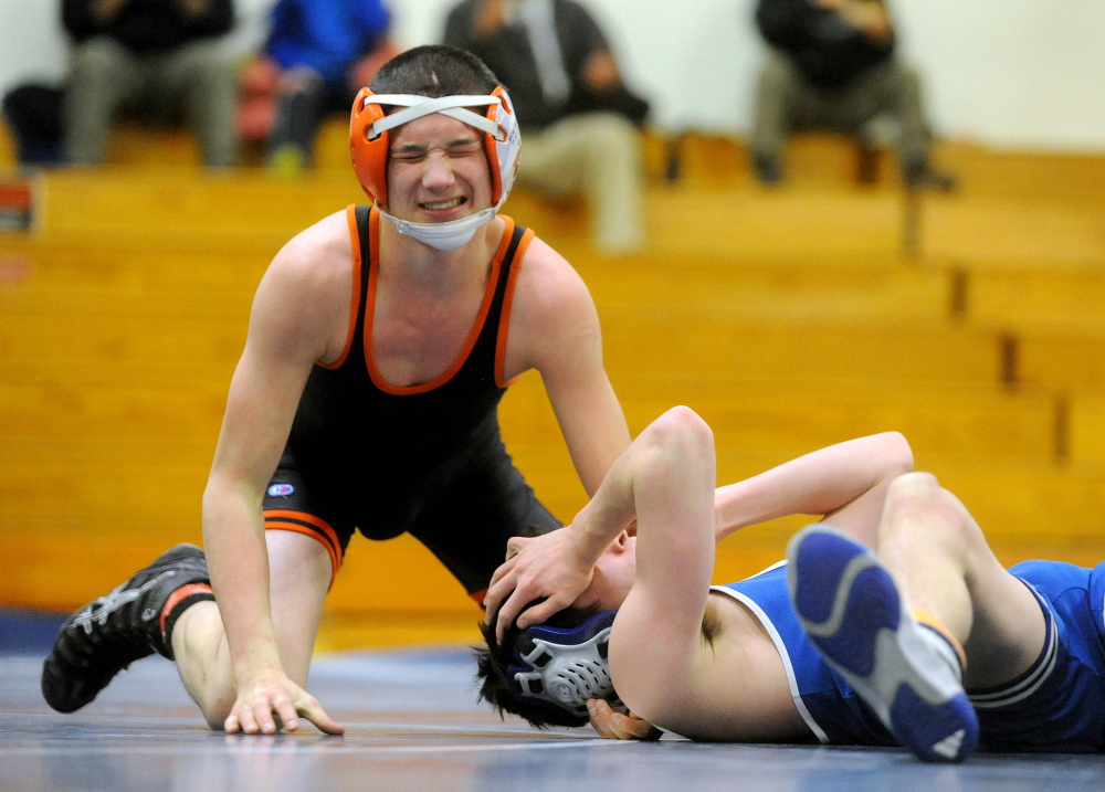 Skowhegan's Samson Sirois, left, and Erskine's Cam Grass, react after they wrestled in a 120-pound class bout last season in South China. Sirois is wrestling in the 132-pound class this season.