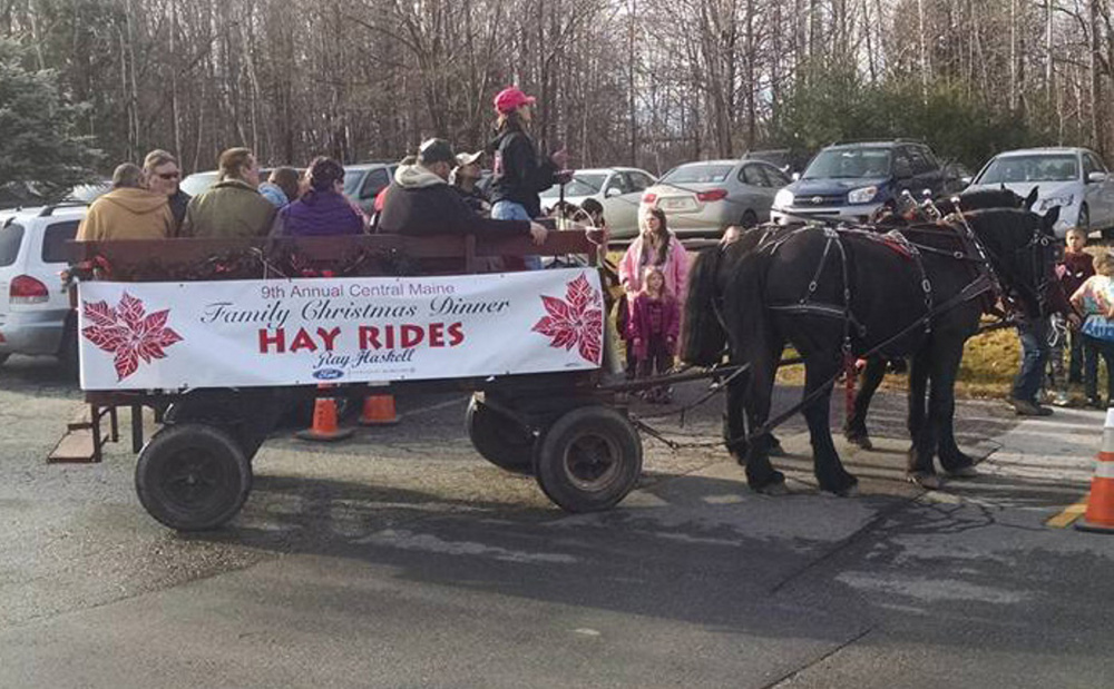 The wagon ride at the Central Maine Family Christmas Dinner, with driver Cathy Simmons, is shown Friday. The wagon was later hit by a car, killing one woman and injuring six.