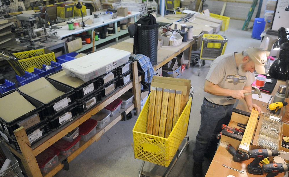 Mark Dunham builds an ice fishing trap at the Jack Traps manufacturing shop in Monmouth on Monday.  The ice fishing outfitter hand-builds traps that are sold around the globe. The late ice-in this year has put a pinch on business, but he's optimistic it will pick up when the lakes freeze.