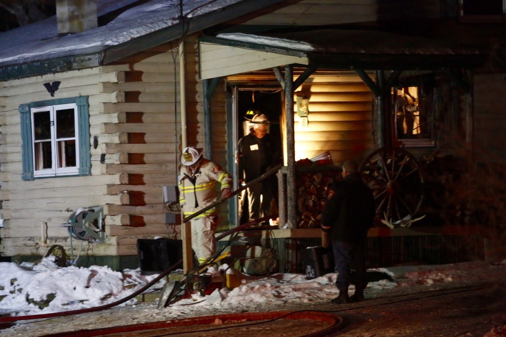 Firefighters leave the residence at 8 Bear Run Road where a fire claimed the life of Barry Dunlap, 55, Sunday night. Derek Davis/Staff Photographer