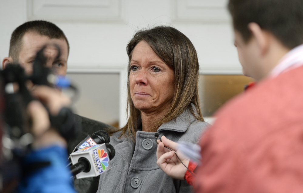 Susan Johnson speaks to the press after James Pak pleaded guilty in York County Superior Court in Alfred on Wednesday. Pak's plea spared Johnson from having to testify about how she feigned being dead beneath the Christmas tree after she was shot in her apartment on Dec. 29, 2012.