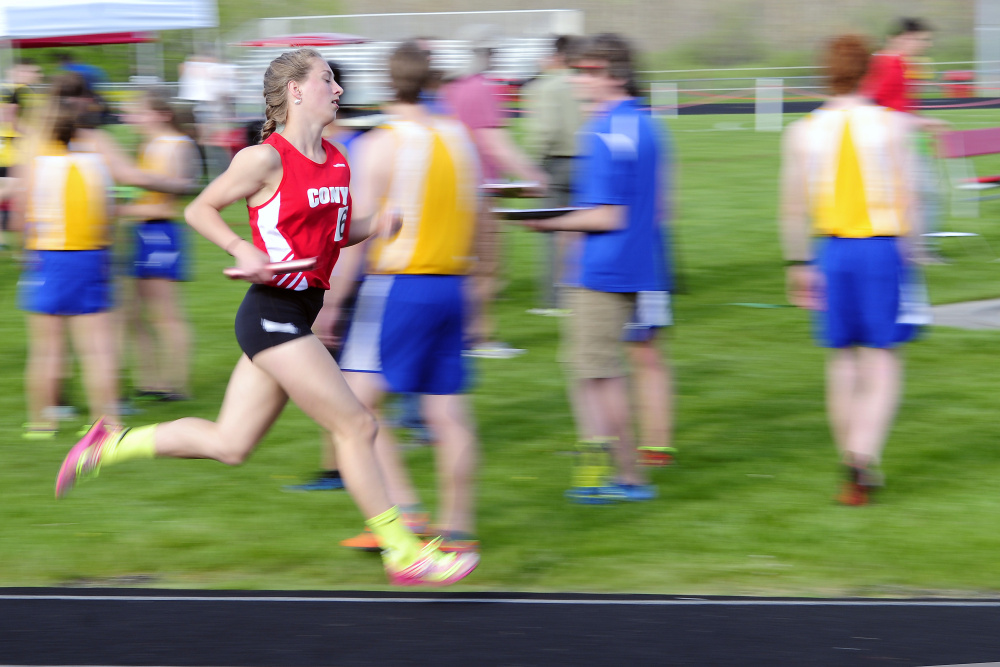 Cony's Anne Guadalupi runs the anchor leg for the 4x800 meter relay team during the annual Capital City Classic in Augusta last month.
