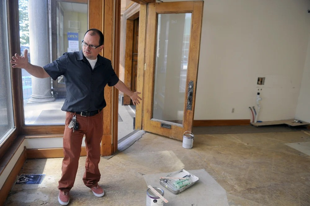 University of Maine at Augusta art professor Peter Precourt discusses on Tuesday the temporary art gallery he plans to open on Water Street in Augusta.