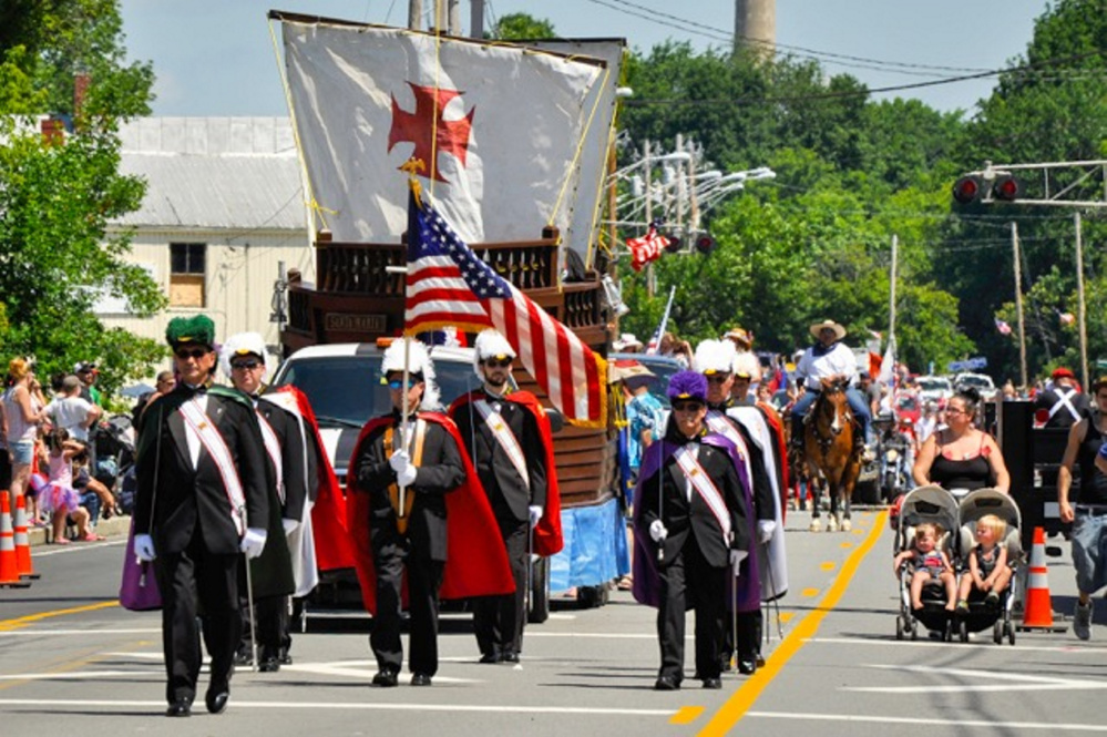 The Knights of Columbus march in the Winslow Family 4th of July parade on July 4. Organizers of the annual event say the town is increasing its fees in an effort to drive the celebration elsewhere.