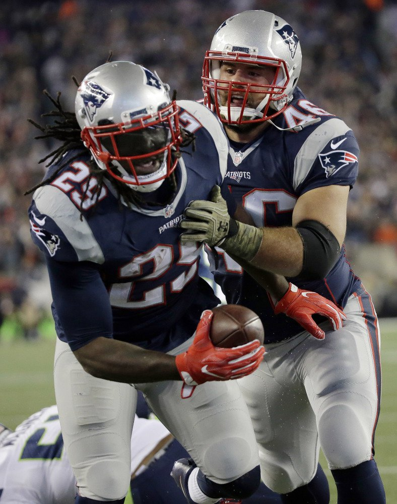 LeGarrette Blount celebrates one of his three touchdowns with fullback James Develin. Blount has 12 rushing touchdowns this season, two shy of Curtis Martin's team record.