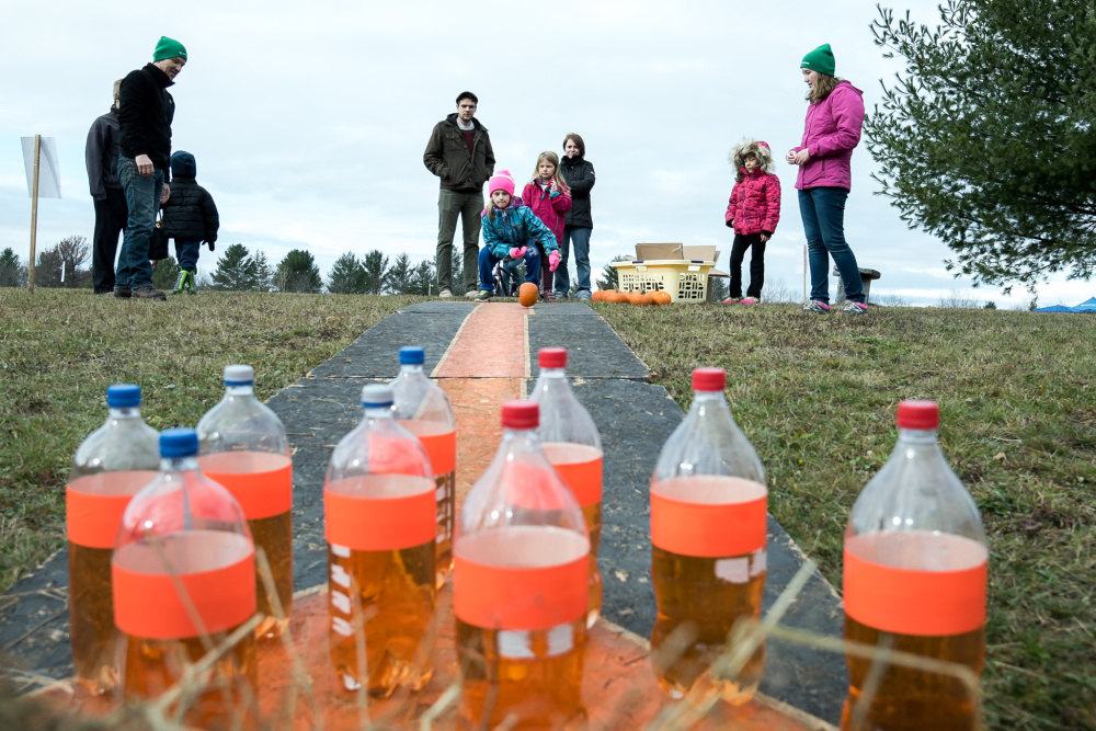 Trying to roll a pumpkin in a straight line capture children's attention Saturday at the pumpkin bowling activity  at the Quarry Road Trails recreation area in Waterville.